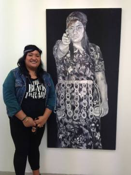 "Ana Lakusa with work from her ""From Heaven to Hell"" series"