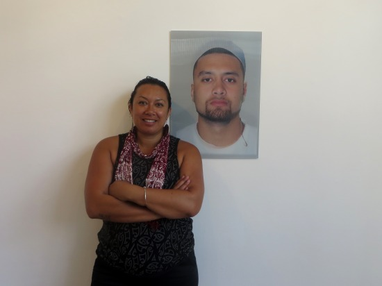 "Leilani Kake with her work, ""MALE - Maori or Polynesian"" (2014) // Photo courtesy of PIMPI"